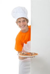 proud child showing his pizza cooking skills